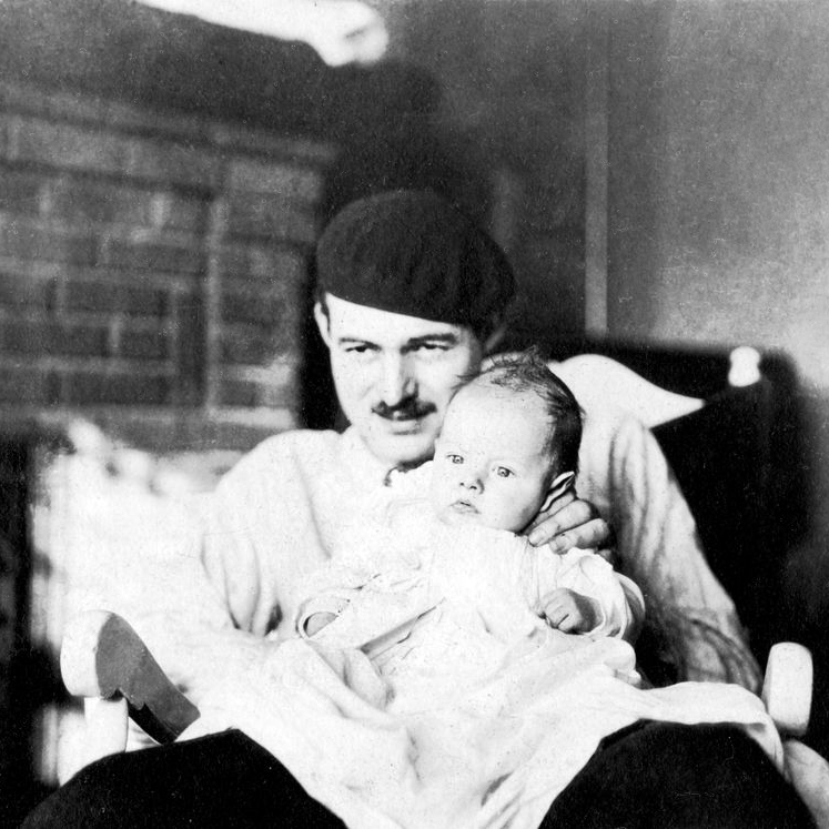 "EH5180 Paris Years:1922-1930 Ernest Hemingway wearing hat and holding John (Bumby) Hemingway. Series 03. Paris Years, 1922-1930. Box 3, Folder 21. Please Credit: ""Ernest Hemingway Photograph Collection. John F. Kennedy Presidential Library and Museum, Boston."""